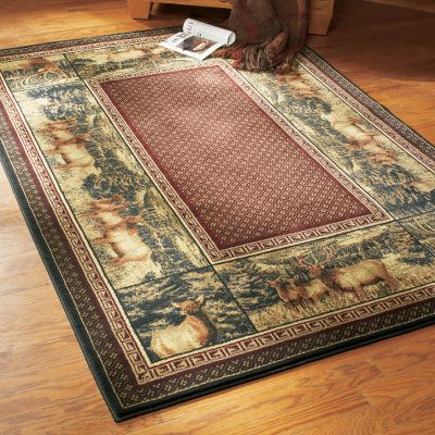 Hunting Our exquisite Grand River Lodge Hautman Area Rug is sure to add class and outdoor flare anywhere you lay it. Truly a work of woven art. Its stain-resistant and has a 10-color heat-set olefin yarn face with four-side overlock serging and jute-cotton backing. Provides outstanding design clarity and long-lasting durability. Cleaning is easy with a vacuum, or spot clean using mild detergent in water. Imported. 311 x 53. Designs: Scenic Cabin, Crow River Ducks, Evening Whitetail, Buck, Moose. - $99.99