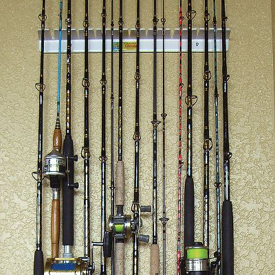 Fishing Got a big pile of rods standing in the corner of the garage Get organized with the Piranha wall rod rack. One-piece rack holds rods and reels vertically out of the way. Tapered, vinyl-coated slots ensure proper fit for any-size rod. Grips rod firmly, but safely. Holds 12 to 14 rods and reels by staggering the height of the rods in the rack. - $22.99