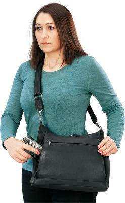 Money-saving combo matches one of our most popular concealed-carry handbags with the nonlethal pepper-spray gun that takes out attackers up to 25 ft. away. Gun includes 28-gram OC cartridge that contains up to seven 25-ft. blasts. Trigger-activated LED (batteries required) allows better aim at night and will temporarily disorient your assailant. The gun comes loaded with a water-test cartridge for practice. The handbag is constructed premium leather, includes a removable, slash-resistant reinforced strap and a padded ambidextrous internal holster. Fits compact semiautomatics and small revolvers. Three internal pockets for storage and two large exterior pockets. Adjustable strap for cross-body wear. Imported. Dimensions main compartment: 10-1/2H x 12W. Overall dimensions: 11H x 14W x 5-12D. Available: Saddle Tan. - $99.99