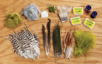 Flyfishing This material kit contains all the necessities for tying wooly buggers, pheasant tail, elk hair caddis, rock worm, adams and parachute adams flies. Gunnison Material Kit includes: 8, 12 and 14 size hooks, gray dubbing, olive dubbing, medium chenille, marabou, grizzly hackle, brown hackle, black thread, fine copper wire, peacock herl, pheasant tail, elk hair and white poly yarn. Type: Fly-Tying Kits. Type Gunnison. - $18.88