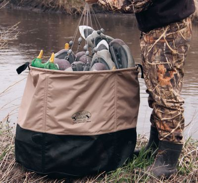Hunting Tired of stuffing decoys and rigs into the narrow openings of most bags? Load and unload quickly and easily using the ultrawide opening of the Big-Top Decoy Bag. 600-denier polyester construction stands up to the punishment of truck and boat travel. PVC-coated mesh bottom drains water. Two carry handles make transport easy. Holds over two-dozen duck or 12 goose decoys. Imported. Dimensions: 26H x 30 dia. Size: BIG TOP. - $59.99