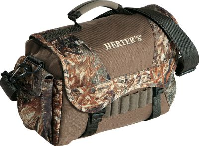 Hunting A lighter bag great for carrying your outdoor and hunting essentials, this messenger-style Quick Hit Timber Bag from Herters features multiple zippered pockets and an adjustable shoulder strap. A convenient carry handle is positioned on top of the fold-over flap. Imported. 12L x 5W x 7.5H. Capacity: 450 cu. in. Camo pattern: Mossy Oak Shadow Grass Blades. Color: Mo Shdw Grass Blades. Type: Blind Bags. - $18.88