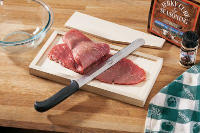 Entertainment Make perfect jerky every time with this Jerky Board and Knife Set. It includes a double-sided cutting board made of select hardwood. One side is made for cutting 1/4-thick strips, and the other side for cutting 3/8- thick strips. The custom-crafted hollow-ground knife is razor sharp. It comes with an insert for delicate meat cuts and easy vegetable slicing. Also included is a FREE packet of High Mountain Original Blend Jerky Cure and Seasoning, and a FREE 10-oz. shaker bottle of Western Sizzle Steak Seasoning. - $44.99