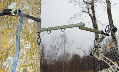 Hunting If youre a treestand bowhunter, youll love having your bow and other essential gear within reach at all times. The HME Strap-On Bow Hanger securely mounts to a tree with its heavy-duty and super-strong ratchet strap. This eliminates the need to screw anything into the tree, which is illegal in most federal, state and county forests. This easy-to-apply device provides you with a pivoting-arm bow hanger. This arm also supplies a carabiner-style hanger for your backpack and two hooks for your rattling antlers, calls, binoculars or any other gear youll want at your fingertips. The 6-ft.-long ratchet strap fits around most trees. Bow hanger extends out to 25. - $19.99