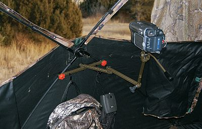 Hunting Place your camera in an optimal viewing position inside any hub-style ground blind. Pivoting arms and a full range of vertical adjustment allow you to get a perfect shot at your target and a perfect video angle with your camera. Once the camera is in the desired position, you can raise or lower it by loosening the locking wing. Mounts to the ground-blind cross rails. Includes two accessory hooks for hanging calls, a rangefinder or backpack. - $14.88