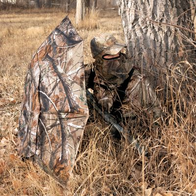 Hunting Made from durable windproof nylon, this lightweight umbrella offers concealed protection in a stand or on the ground. Attached to a tree, it keeps you and your weapon dry. Propped on its side, it doubles as a quick, convenient ground blind. Folds up for convenient transport. Includes two tree mounting brackets. Imported. Camo pattern: Realtree AP. Color: Camo. Type: Portable Blinds. - $29.88
