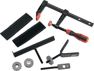 "Most shooters need to mount a spotting scope, umbrella or shooting rest at some point. This rugged, bar-type clamp set includes a spotting scope mount, a foam padded V notch gun support and an umbrella bracket. The clamp opens to 6-3/4"" x 3-3/4"" deep and can be fitted to benches, tables, fences, trees or just about any stable base. Its also ideal for cameras and binoculars. Imported. - $19.88"