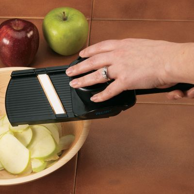 Cut deli-quality meats and cheeses or slice fruits with ease with this handheld mandolin. The ceramic blade maintains sharpness up to 15 times longer than stainless-steel blades. An ergonomic/angled handle gives you stress-free slicing while the food holder prevents injury. The dual cutting/slicing direction ceramic blade won't brown fruits and vegetables. Dimensions: 12 L x 3-3/4 W x 2-3/8 H.Weight: 13 oz. Color: Brown. - $19.99