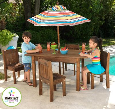 Camp and Hike This fun, kid-sized and sharp-looking furniture set four stacking chairs, one table and an umbrella will be the hit of the backyard. Hardwood furniture is crafted with reinforced wooden panels for long-lasting strength and durability. The vibrant and striped umbrella offers a protective shade from the sun and its UV coating keeps it looking like new. Includes instructions. Imported. Set includes: Table: 24.19H x 45.63W x 29.75D. Chairs: 15.5H x 9.25W x 9D. Umbrella: 59.4H. - $229.99