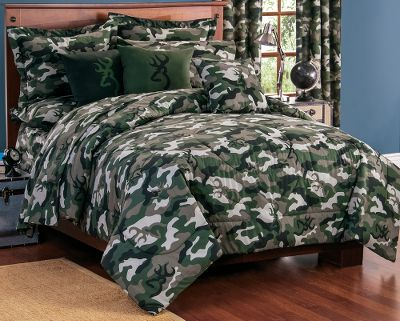 Hunting Complement your bedroom collection with camo bedding accented with Browning Buckmarks. Comforter is filled with polyfill insulation for warmth. 55/45 cotton/polyester. Machine washable. Made in USA. Sets include: one comforter, two standard shams (twin has one standard sham). Available: Twin 65 x 90 comforter. Full 80 x 90 comforter. Queen 86 x 94 comforter. Size: TWIN. Color: Camo Green. - $89.99