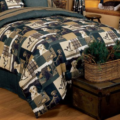 Entertainment Impart an outdoor theme and feel to your bedrooms with these Comforter Set bedding collections. Comforter Sets include comforter, skirt and sham(s). Machine washable. Made in USA. Comforters - Twin (65 x 90), Full (80 x 90), Queen (86 x 94), King (104 x 94). Bed Skirts - Twin (39 x 75 x 14), Full (54 x 75 x 14), Queen (60 x 80 x 14), King (78 x 80 x 14). Shams - Standard (21 x 27 x 3), King (21 x 37 x 2). Available: Dogs and Ducks With the depiction of three Labrador retrievers staring intently at the distant horizon, this set captures the images of the hunters best friend right where they want to be in the field awaiting the next flock. In addition to the yellow, chocolate and black Labs, flying and sitting ducks are portrayed against deep hunter green and warm brown backgrounds, making this ensemble ideal for any waterfowler or dog lover. The bed skirt is textured hunter green. Crafted of polyester/cotton percale. Size: TWIN. Color: Chocolate. - $119.99