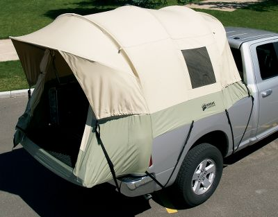 Camp and Hike The unmatched durability and heavy-duty weather resistance of this rugged canvas truck tent ensures it will outperform and outlast all others. The 8-1/2-oz. 100% cotton duck canvas with Hydra-Shield is durable, watertight and breathable. With its sturdy steel frame, the Kodiak withstands the strong winds and storms Mother Nature throws at it. The tunnel-shaped, tailgate-down design maximizes interior space to the fullest, while the 5-ft. ceiling height allows for plenty of head room. A set of clamp-on rails easily mount to your truck for a secure fit. And if you want to get some fresh air, open one of the five windows for excellent ventilation and openness. Cab-access window allows you to run a power cord from your cab to power small appliances. Large D-shaped door with YKK zippers. Two sewn-in gear pockets. Includes carry bag. Fits full-size trucks with 5-1/2-ft. to 6-1/2-ft. long beds. Height: 5 ft. Imported. - $349.99