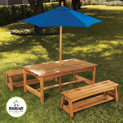 Camp and Hike Pint-sized picnickers can now enjoy a table and bench set sized just for them. Wide table and matching benches with convenient storage areas are crafted from weather-resistant wood to resist warping and weathering. A canvas umbrella keeps fair skin protected from the sun. Detailed, step-by-step instructions make assembly a breeze. Great for any patio or backyard.Dimensions: Table 42-1/4L x 23W x 19H. Benches 36L x 8-1/2W x 10-3/4H. - $229.99