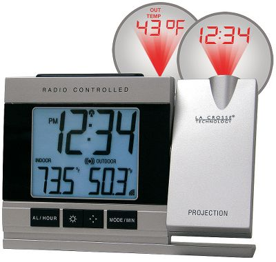 The last thing you want to do when you're snuggled into bed and its bitter cold outside is get up to check the time or temperature. Now you wont have to with the La Crosse projection alarm clock. Effortlessly project the time and outside temperature onto the ceiling or wall in large, auto-focusing, easy-to-read numbers. Simply move the projection arm and adjust it until it projects in the area you wish. The digital display shows indoor temperature as well as time in hours, minutes and seconds. An included outdoor sensor unit can be placed up to 330 feet from the base and continue to relay outside temperatures. Weather information is updated every four seconds, and atomic time and date automatically reset in case of a power outage. Automatically adjusts for daylight saving time. 24-month battery life. Perpetual Calendar. Time alarm with snooze and time-zone setting. Runs on two AA batteries (not included) or included AC power adapter. Dimensions: 5.6L x 1.4W x 3.6H. Type: Alarm Clocks. - $29.88