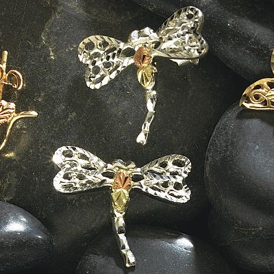 Entertainment Anyone who has admired the dragonfly in flight will love this artistic rendition. Crafted by one of the leading jewelers specializing in Black Hills gold, these pieces combine the natural beauty of this precious metal with masterful designs inspired by nature. These sterling silver Dragonfly Earrings are accented with 12-kt. gold.Dimensions: 43/64L x 39/64W. - $59.99