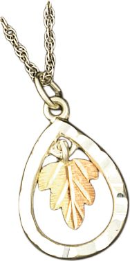 Entertainment This pendant combines the natural beauty of Black Hills Gold with masterfully crafted designs from nature to create this exquisite line of jewelry. Handcrafted of 10-kt. gold and fine silver. Made in USA.Dimensions: 3/4L x 1/2W. - $64.99