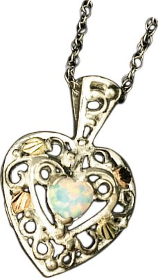 Entertainment Crafted by one of the leading jewelers specializing in Black Hills gold, this gold-and silver pendant combines the natural beauty of these precious metals and stunning opal with masterful, nature-inspired designs. Made in USA. - $79.99