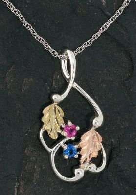 Entertainment Customized pendant has a cast, sterling silver frame surrounding a 12-kt. pink leaf, a 12-kt. green leaf and your choice of one to six 3mm synthetic birthstones. Sterling silver rodium chain. Made in USA.Pendant dimensions: 1-1/4L x 1/2W.Chain length: 18.Available: 1 stone, 2 stones, 3 stones, 4 stones, 5 stones, 6 stones.Note: To order, please enter the first 3 letters of each month youd like personalized on your ring (see More Views image) on each line after adding to your cart. Example: Line 1: JUN, Line 2: SEP. Must be in all CAPS. If preferred in a certain sequence enter them in the order wanted. Each field must be filled to complete the order. - $129.99