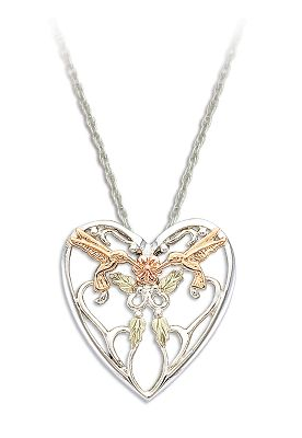 Entertainment Framed by a heart, two 10-kt. hummingbirds hover above 12-kt. green leaves and a 10-kt. pink flower. Made in USA. Pendant dimensions: 1W x 1H. Chain length: 18. Color: Green. Gender: Female. Age Group: Adult. Type: Necklaces. - $139.99