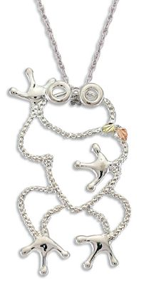 Entertainment The diamond-hammered silhouette of this playful frog pendant gives it a sparkling character. His feet and eyes are smooth sterling silver, making them really pop out from the figure. A simple smatter of pink and green 12-kt. Black Hills gold hand-engraved leaves sit on his shoulder. This comes on an 18 rhodium-plated sterling silver chain. Made in USA.Pendant dimensions: 1-1/2L x 15/16W. - $74.99