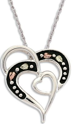 Entertainment A beautiful edition to your Black Hills gold jewelry collection. Features an antiqued double-heart-style pendant with two pink and two green 12-kt. hand-engraved leaves on an 18 rhodium-plated sterling silver chain. .8 wide.Pendant: .8 wide x 31/32 long.Chain length: 18. - $89.99