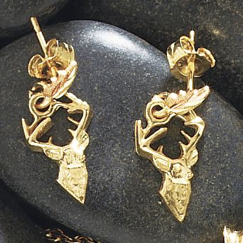 Hunting The natural beauty of Black Hills gold shimmers in these earrings. Handcrafted in the shape of a whitetail deer, these dangle earrings are 10-kt. gold with 12-kt.-gold red and green engraved leaf accents. The posts and ear nuts are made of 14-kt. gold. - $159.99