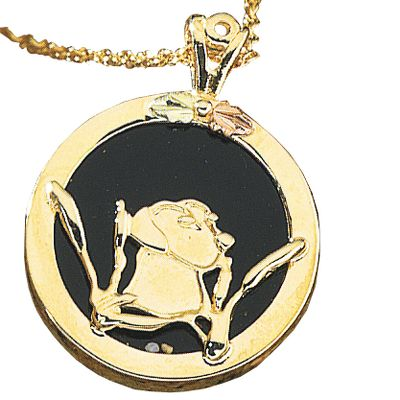 Entertainment Crafted by a jeweler specializing in Black Hills gold, this lovely pendant proudly displays a Labrador Retriever against a background of detailed cattails. It features the beautiful dark tone of onyx. Includes a gold-filled chain. Made in USA.Pendant dimensions: 3/4L x 1W.Chain length: 18. - $242.99