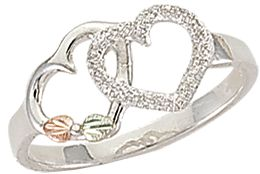 Entertainment Handcrafted by one of the leading jewelers specializing in Black Hills gold and made of dazzling sterling silver. This ring boasts two intertwined hearts adorned by one green and one pink hand-engraved leaf, both made of 12-kt. gold. Rings front design is 0.36H x 0.59W. Made in USA. Sizes: 4-10. Half sizes to 10. Size: 5.5. Color: Silver. Gender: Female. Age Group: Adult. Type: Rings. - $74.99