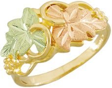 Entertainment Handcrafted by one of the leading jewelers specializing in Black Hills gold. The wondrous 10-kt. gold band is adorned by one green and one pink hand-engraved leaf, both made of 12-kt. gold. Rings leaf design is 0.47H x 0.9W. 100% Black Hills gold. Made in USA. Sizes: 4-10. Half sizes to 10. - $379.99