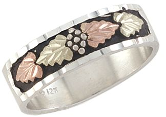 Entertainment Handcrafted by one of the leading jewelers specializing in Black Hills gold, this sterling silver ring features two green and two pink hand-engraved leaves made of 12-kt. gold. Rings antique-looking leaf design is 0.29H x 0.98W. Made in USA. Sizes: 9-14. Half sizes to 14. - $139.49