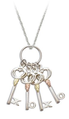 Entertainment Crafted by Landstroms, one of the leading jewelers specializing in Black Hills gold. This brilliant necklace features two keys with hand-engraved 12-kt. pink leaves and two keys with hand-engraved 12-kt. green leaves. Includes a rhodium-plated sterling silver chain. Made in USA.Pendant dimensions: 1.75L.Chain length: 18. - $103.49