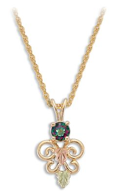 Entertainment This beautiful, handcrafted 10-kt.-gold pendant features a 4mm genuine mystic fire topaz stone cresting a butterfly-shaped set of scrolls. Green and pink 12-kt. Black Hills gold leaves embellish the scrollwork, and its elegantly displayed from a complementary 18 12-kt.-gold chain. Made in USA.Pendant length: 3/4. - $179.99