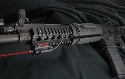 Entertainment Outfit your rail-equipped rifle with a laser sighting system to improve your accuracy in low-light shooting situations. The Uni-Max pulsating laser fits on almost any rifles Picatinny rail with a low-profile and lightweight, yet rugged design that makes this laser system superior to some cheaper and bulkier designs. It features the Momentary Activation Switch (MAS) that lets you put sight activation at your fingertips without taking your hand off your firearm to reach forward for manual activation. A lithium 1/3N battery (not included) provides one hour of continuous use. The straight cord between the switch and laser wont stretch, unwind or dangle like some coil-corded designs. MantaRail Momentary Cord Control System solves the common problem of cords falling off the gun because the adhesive got wet or old and lost its adhesion in inferior products. The MantaRail completely houses the pressure pad of the MAS and securely clamps to the rail, eliminating any need for hook-and-loop strips, tape or messy glue. Three included MantaClips hold any extra cord that could protrude or dangle and tucks it up close to the rail by clipping it in place up and out of the way. With this innovative system you receive a MantaRail momentary switch control system, MantaClips, a momentary switch and a Uni-Max rail mounted laser. Five-year limited warranty. Weight: 1 oz. - $159.00
