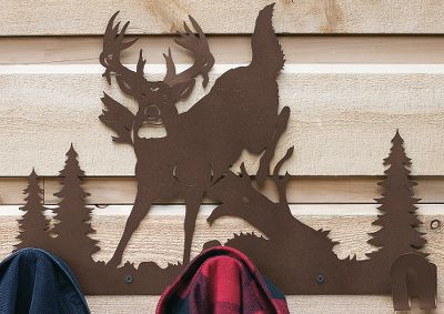 Hunting Like shadowed reflections on your wall, these laser-cut silhouettes show off exactly what you like most about the outdoors. They make a handsome addition to any home or rustic retreat. Each is laser-cut from cold-rolled steel and has a powder-coated finish for lasting durability. Ready to hang. Molly anchors for screwing into studs for stability is recommended. For indoor and outdoor use. Made in USA. Available: Jumping Whitetail Deer (13.5H x 19.8W) Cabin (12H x 19.8W) Type: Coat Racks & Hooks. - $49.99