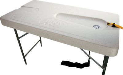 "Fishing A portable fillet table that's easy to transport, easy to clean and easy to set up and take down. Heavy-duty individually adjustable legs position the table for optimal height and stability. The spacious nonslip fish-cleaning surface has room for one person to work on each side. Built-in sink with standard size drain and hose attachment and a molded chute for discarding waste. Table is weather- and UV-resistant. Built-in ruler on both sides of the table for measuring fish. Made in USA.Surface dimensions: 23-1/2""W x 47""L x 3-1/2""H.Adjustable Height: 33-1/2"" to 42-1/2"" - $149.99"