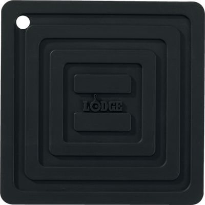 Lodges Silicone Square Pot Holder protects your hands from heat up to 250F and tabletops from scorching while stabilizing a full skillet to prevent it from spilling. Nonslip silicone surface ensures your skillet or Dutch oven stays put wherever you set it. Cleans up easily in seconds. Dishwasher safe 5-7/8 X 5-7/8. Colors: Black, Red, Blue, Green. Color: Green. Type: Pot Holders. - $4.99