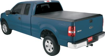 Motorsports The cargo in your pickup bed gets the protection it needs from the elements with this easy-to-install roll-up cover. The double-sided matte black fabric is tear-resistant and made to last. A built-in automatic tension control ensures a snug fit, and multifinned rubber seals on the front and rear rails keep dust and moisture out. Black rails and bows with strong, rigid extrusions give it durability and good looks. Heavy-duty Velcro fastener is securely fixed to side rails with durable adhesive for easy open-and-close operation. Limited lifetime warranty. Size: SHORT. Color: Matte black. Type: Tonneau Cover. - $309.99