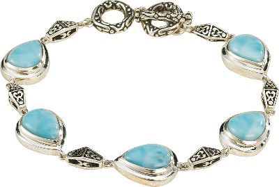 Entertainment Beautifully set, Caribbean-sea-blue larimar is accented with highly polished sterling silver. Heat and pressure from volcanic lava flows crystallized larimar gemstones eons ago, and they went largely undiscovered until 1974 when a Peace Corps volunteer stumbled across a deposit of the brilliant blue stones along a remote Caribbean seashore. Now it's treasured for its rich blue hues and one-of-a-kind look. The bracelet is fashioned from .925 sterling silver and features a five bezel set of 8mm x 11mm pear-shaped larimar stones. Each is connected with a filigree bar. Five horizontal bars of filigree silver highlight the piece. Comes with a filigree toggle. Length: 7-1/2 . Color: Caribbean. Gender: Female. Age Group: Adult. - $229.88
