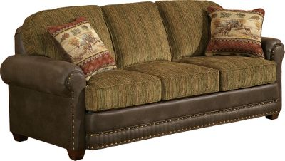"Hunting Comfort will surround you amidst the serene portraits of beautiful whitetails in their element. This love seat features a kiln-dried, hardwood, fortress frame construction along with a high-density/high-resiliency cushion core that has fiber wrapping for total comfort. The semi-attached pillow backrests and plush seat cushions are upholstered in a rich, mossy-green marbled chenille. Rimming each cushion is a band of durable faux leather in a deep chocolate brown. Handcrafted 5 8"" brass nail trim and matching dark-brown legs. Made in USA. Sofa shown.Dimensions: 65""L x 38""D x 39""H. - $1,449.99"