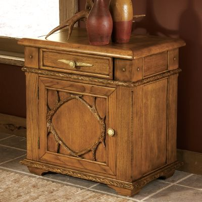 Entertainment Tastefully crafted for statement-making style, this beautiful hardwood accent table brings class to any home. It features Handmade detailing on the door, which opens to a shelved storage area. Felt-lined art drawer. Wood top. Faux antler resin handles. Dimensions: 28 L x 19 D x 28 H. - $799.99