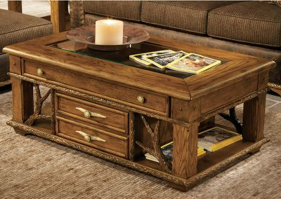 Entertainment Tastefully crafted for statement-making style, this beautiful hardwood coffee table brings class to any home. Kiln-dried, fortress frame construction offers resilient durability. The large felt-lined drawer and glass top create a elegant display case for your prized mementos or careworn hunting gear. Handcrafted branch-like accents and trip, and faux antler resin handles. Drawer: 37-1/2L x 24-1/2W x 3H. 50L x 30D x 20H. - $1,199.99