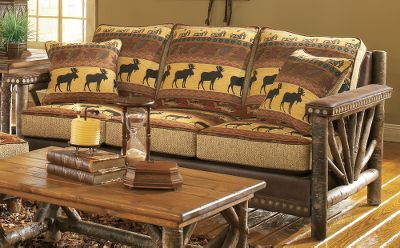 Hunting Bring the look of a vacation lodge to your home with this handcrafted, log-accented love seat. Handcrafted, authentic rustic poplar wood arms have a sunburst twig design. The fully upholstered seating area invites you to sit down in superb comfort. The patterned chenille fabric shows a bull moose, fish and forest leaves, all in nature-rich colors of tan, forest green, russet burgundy and black. Granite-colored, tweedlike chenille boxing fabric and chocolate brown faux leather for the body and contrast welting match nicely with the pattern. Hand-applied Cabelas nail trim is featured at the arms and base. Seat cushions are reversible to the chocolate brown faux leather. Includes a pair of throw pillows. Assembled with kiln-dried, fortress frame construction. Machine-tied coil seating unit and high-density, high-resiliency cushions with fiber wrapping provide level comfort across the seating area. Made in USA. 59L x 40D x 38H. Color: Forest Green. - $1,899.99