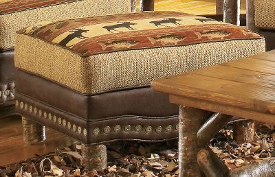 Hunting Complete your Wildwood living room set and gain out-of-sight storage for clutter with this handcrafted, log-accented storage ottoman. The fully upholstered leg rest invites you to prop your feet up in superb comfort. The patterned chenille fabric shows a bull moose, fish and forest leaves, all in nature-rich colors of tan, forest green, russet burgundy and black. Granite-colored, tweedlike chenille boxing fabric and chocolate brown faux leather for the body and contrast welting match nicely with the pattern. Hand-applied Cabelas nail trim is featured at the base. Assembled with kiln-dried, fortress frame construction. Made in USA. Dimensions: 27L x 23D x 17H. Color: Forest Green. - $799.99