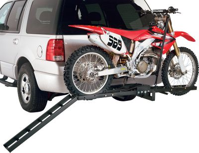Auto and Cycle Easily haul your dirt bike with Masterbuilts Motorcycle Carriers. Plug carrier into any 2 receiver hitch, roll your motorcycle up the ramp and into the carrying channel using the included loading ramp. Secure the tires with the included bolt-in pins. The frame locks your bike in place while tie-downs (not included) secure the upper portion to two lugs in the rack. Once the motorcycle is in place, unhook the ramp and secure it on the frame for convenient hauling. Heavy-duty, 2 tubular steel construction. The carrying channel measures 76L x 5W and easily adjusts to fit various motorcycles. Hitch pin not included. Available: Standard Carrier (fits up to 450cc bikes). Wt. capacity: 300 lbs. Type: Motorcycle Carriers. - $139.99