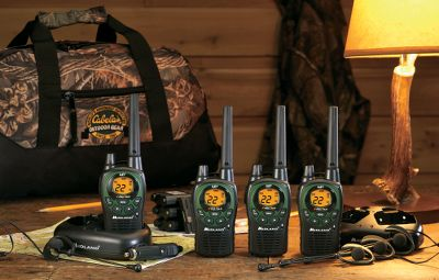 "Hunting All the equipment you need to stay connected with three of your hunting partners. The pack includes four 991 radios, four battery packs, two DC chargers, four headsets, two AC chargers, two dual drop-in chargers and a Seclusion 3D duffel bag. Cabela's-exclusive Bubba 991 features 5 watts of power, allowing you to keep in contact from up to 34 miles away (under ideal conditions). Extremely easy to use; just switch it on, set it to one of the 22 channels, and start talking. Backlit LCD. eVox allows hands-free operation. Auto stealth squelch eliminates popping noise between transmissions. Hi/Med/Low switchable power and battery life extender. Includes external accessory jacks for use with included headsets. Uses three AA batteries (not included) or rechargeable battery pack. Seclusion 3D duffel bag has rugged 1,000-denier nylon bottom that's wear- and water-resistant. A $179.95 value.Radio: 6-1/2""L x 2-1/4""W x 1-1/4""H. Duffel: 18""L x 9""W x 9""H. - $139.88"