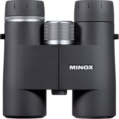 Hunting Minox continues a tradition of optics innovation with the HG series. Engineered in Germany to the highest standards, these binoculars combine elite optics performance with a lower weight and price than similar models from competing brands. M multicoating on the lenses consists of up to 21 layers on the special optical glass from German glass specialist Schott AG. By adapting the various wavelengths of visible light, the coatings increase light transmission to an impressive 92%, while significantly improving brightness, contrast, detail and color rendering. Silver-based MinoBright technology guarantees 99.8% efficiency of the light reflected at the mirror surface. Aspherical lenses enhance contrast and sharpness of the image from edge to edge. Internal anti-reflection and anti-glare coatings improve contrast. One turn of the Quick Close Focus knob adjusts from close-up to infinity. Use the scale on the focusing wheel as a reliable rangefinder. Fully sealed and argon-purged to be waterproof and fogproof. Lightweight magnesium body has rugged body armoring for a secure grip and added protection. Comes with case and neoprene neck strap. - $1,295.99