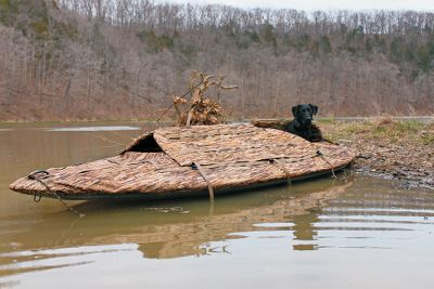Hunting Its part layout blind, part boat and perfect for down-and-dirty duck hunting in flooded fields and other shallow-water areas, where launching a full-sized boat is impractical or impossible. Its self-balancing tunnel hull offers unmatched stability for stand-up poling through thick cover and shallow water. The Fatboy also doubles as a floating layout blind with the included Realtree MAX-4 InvisaHide Cockpit Blind. The blind attaches to the deck and features swing- open doors, adjustable dog access behind the hunter, and slats for adding grass or stalks. Large cockpit fits you, your dog and up to six-dozen decoys. Built-in flotation chambers fore and aft make it virtually unsinkable. Cushioned Invisalounge Layout Seat adjusts in pitch from 10 to 90. Transports easily in a full-sized truck bed. Tow hook included. The Invisalounge dog cover is also included with the Cabelas Fat Boy Layout Boat combo. Weight: 90 lbs. Dimensions: 13L x 48W x 15H. Color: Olive Drab. Color: Olive Drab. Gender: Male. Age Group: Kids. Type: Duck Boats. - $2,299.99