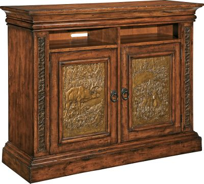 Hunting Bring the natural majesty of the Big Sky Country to your bedroom dcor with the premium Montana Collection. This TV chest features richly grained birch and select maple with a rustic Deer Lodge finish for the perfect mix of elegance and careworn appeal. Each is truly a handcrafted work of art offering top-grade functionality and heirloom-quality durability. Hammered-metal inserts add eye-catching texture and perfectly complement the natural warmth of the wood frames. The doors feature a beautifully cast wildlife scene, and two small cubbies can house electronic media devices. Set your TV directly on the top, or pair it with the Montana Dick Idol TV Wall Chest that houses your TV behind matching doors.Dimensions: 45 H x 56 W x 20 D. - $1,499.99