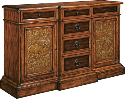 Hunting Bring the natural majesty of the Big Sky Country to your home dcor with the premium Montana Collection. This server features richly grained birch and select maple with a rustic Deer Lodge finish for the perfect mix of elegance and careworn appeal. Two large doors feature beautifully cast wildlife scenes, and six drawers custom hardware add to the rustic elegance of this piece. Each is truly a handcrafted work of art offering top-grade functionality and heirloom-quality durability. Hammered-metal inserts add eye-catching texture and perfectly complement the natural warmth of the wood frames. All fully sealed, felt-lined drawers are made of solid wood with first-rate English or French dovetail joinery. Waxed wood-on-wood drawer slides.Dimensions: 40H x 62W x 18D. - $1,619.99