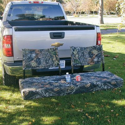 Camp and Hike Get the best seat at the tailgating party when you bring your cargo on this cargo carrier. Once you unpack, it becomes a comfortable padded seat with the included 3 high-density foam seat insert. It even has built-in drink holders. Multifunction, multiposition adjustability allows for a variety of uses. You can sit facing away from or toward your vehicle. Face out to the party or turn around to use your tailgate as a table, or watch a TV in the back of your SUV. Fits standard 2 Class III or IV receiver and has a 600-lb. weight rating. Cargo carrier is powder-coated steel. Cover and backrests are 600-denier polyester with PVC coating. Carry bag included to hold foam insert, cover and backrests. Made in USA.Dimensions: 54L x 20W.Camo pattern: Mossy Oak Break-Up. - $359.99